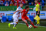 Slovakia midfielder Robert Mak tussles with Wales midfielder Joe Allen during the UEFA European 2020 Qualifier match between Wales and Slovakia at the Cardiff City Stadium, Cardiff, Wales on 24 March 2019.