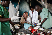 doctor Caterine trying to save the life of Imoha in Mweso Hospital. He soffered of strong TB plus malnutrition and Malaria.