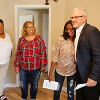 Thomas Wells | Northeast Mississippi Daily Journal<br /> Tamara Norman gets a big hug from Tommy Galloway after Monday's dedication of her Habitat for Humanity home.