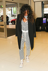 Kelly Rowland and son Titan Jewell Weatherspoon pictured leaving Sydney after winning the Voice Australia 2018. Kelly was wearing a hospital wristband on her left wrist and was walking slowly through the terminal, after being seen struggling to get out of the van. 18 Jun 2018 Pictured: Kelly Rowland; Titan Jewell Weatherspoon. Photo credit: @khapgg/MEGA TheMegaAgency.com +1 888 505 6342
