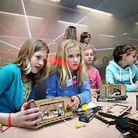 Nederland, Amsterdam , 24 april 2014.<br /> Kick-off Girlsday bij IBM.<br /> Girlsday is een initiatief van VHTO, landelijk expertisebureau meisjes/vrouwen en bèta/techniek om in samenwerking met bedrijven en scholen jonge meisjes kennis te laten maken metbèta/techniek en ICT.<br /> Tijdens Girlsday openen tal van bèta/technische en ICT bedrijven instellingen en science centers hun deuren voor meisjes waar zij kunnen deelnemen aan interessante activiteiten die speciaal voor hen op girlsday worden georganiseerd<br /> Op de foto: een groep meisjes maakt kennis met laser techniek.<br /> <br /> <br /> Foto:Jean-Pierre Jans
