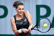 Paris, France - 2017 May 30: Agnieszka Radwanska from Poland plays a backhand during her women's single match first round during tennis Grand Slam tournament The French Open 2017 (also called Roland Garros) at Stade Roland Garros on May 30, 2017 in Paris, France.<br /> <br /> Mandatory credit:<br /> Photo by © Adam Nurkiewicz<br /> <br /> Adam Nurkiewicz declares that he has no rights to the image of people at the photographs of his authorship.<br /> <br /> Picture also available in RAW (NEF) or TIFF format on special request.<br /> <br /> Any editorial, commercial or promotional use requires written permission from the author of image.