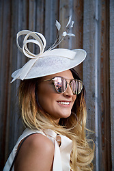 LIVERPOOL, ENGLAND - Thursday, April 6, 2017: Ellie Whittle, 21 from Wigan, wearing a dress from Misguided and a hat from Debenhams, during The Opening Day on Day One of the Aintree Grand National Festival 2017 at Aintree Racecourse. (Pic by David Rawcliffe/Propaganda)
