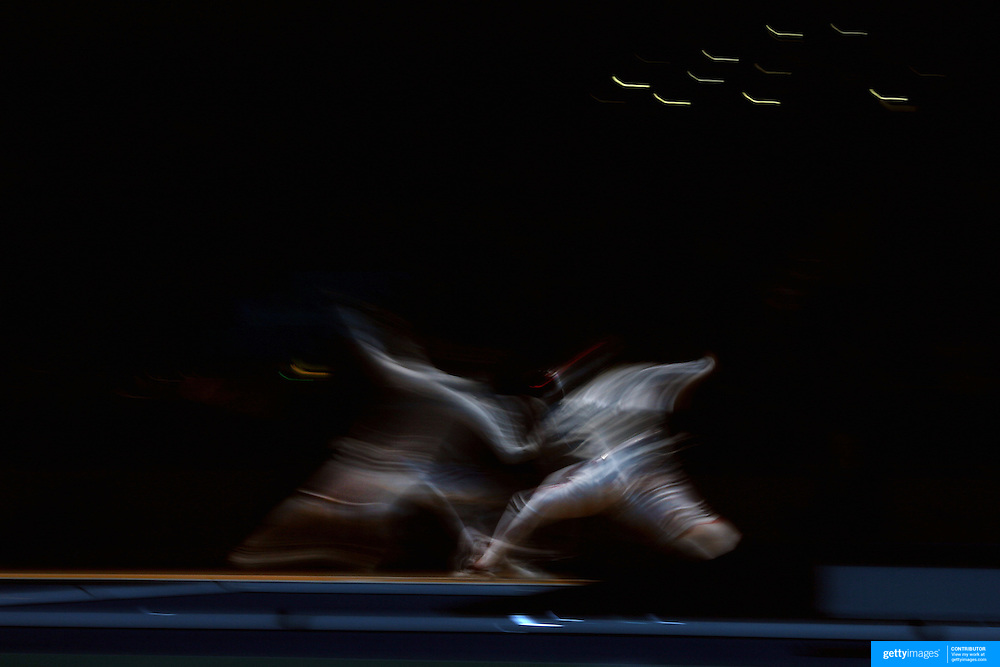 A blur of motion as Byungchul Choi, Korea, (left) competes against Erwan Le Pechoux, France, in the Men's Foil Individual event during the Fencing competition at ExCel South Hall during the London 2012 Olympic games. London, UK. 31st July 2012. Photo Tim Clayton
