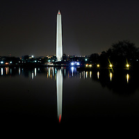 31 March, 2006:  The Washington Monument reflects in the Tidal Basin in a long exposure photograph taken before sunrise in Washington, D.C.