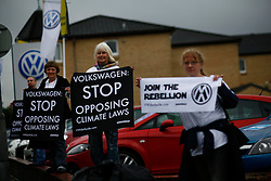 UK SCOTLAND GLASGOW 10SEP11 - Greenpeace activists  protest at the Arnold Clark VW dealership in Glasgow, Scotland...More than sixty Volkswagen dealerships in four countries have today been targeted by Greenpeace campaigners concerned by the car giant's record on climate change...Photo by Jiri Rezac / Greenpeace