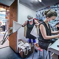 Nederland, Amsterdam, 11 mei 2016.<br /> Sweatshop is de populaire benaming voor een naaiatelier waarin arbeiders in landen als Bangladesh en India kleding maken onder erbarmelijke omstandigheden. Op woensdag 11 mei opent er een heuse sweatshop in de Kalverstraat in Amsterdam. Door een sweatshop na te bootsen, wil Schone Kleren Campagne mensen in Nederland laten ervaren hoe de laaggeprijsde kleding die in diezelfde winkelstraat te koop is, wordt gemaakt. De fabriek ligt verscholen aan de andere kant van een pashokje in de hippe conceptstore 'The Mad Rush' op Kalverstraat nummer 101 en is vanaf 11 mei tot en met zondag 15 mei 2016 te bezoeken. <br /> <br /> Sweatshop is a popular term for a sewing workshop in which workers in countries such as Bangladesh and India make clothes under appalling conditions. On Wednesday, May 11th will open a real sweatshop in the Kalverstraat in Amsterdam. By mimicking a sweatshop Clean Clothes Campaign wants people to experience how the low-priced clothing that is for sale in the same shopping street, is made in the Netherlands. The factory is to visit hidden on the other side of the dressing room in the fashionable concept store &quot;The Mad Rush&quot; on Kalverstraat number 101 and from 11 May to Sunday, May 15th, 2016.<br /> <br /> Foto: Jean-Pierre Jans