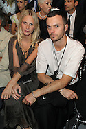 PARIS, FRANCE - JULY 04:  Poppy Delevigne and Kris Van Assche attend the Christian Dior Haute Couture Fall/Winter 2011/2012 show as part of Paris Fashion Week at Musee Rodin on July 4, 2011 in Paris, France.  (Photo by Tony Barson/WireImage)