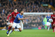 Everton forward Theo Walcott (11) and Liverpool defender Andrew Robertson (26) during the Premier League match between Everton and Liverpool at Goodison Park, Liverpool, England on 3 March 2019.