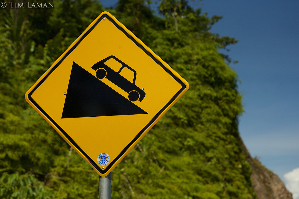 Road sign for steep hill in Halmahera Island, Indonesia.
