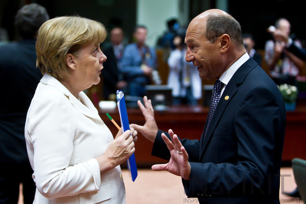 The German Chancellor Angela Merkel speaking to Traian Basescu, President of Romania, on the second day of the EU-Summit in Brussels on Friday 24 June 2011.  PHOTO: ERIK LUNTANG / INSPIRIT Photo