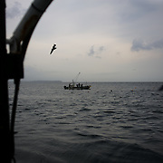 May 29, 2013 - Togura, Japan: A group of fishermen from Togura, recover nets at sea near the small village of Minami Sanriku in Miyagi prefecture. Togura, a small fishing village in Minami Sanriku, was vastly destroyed by the 2011 tsunami that hit the northeast coast of Japan. Thousands died and hundreds of families lost their houses, business and boats. The recovering community works now in a cooperative system where the few remaining boats, spared by the tsunami, are shared by all. (Paulo Nunes dos Santos)