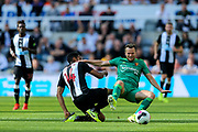Isaac Hayden (#14) of Newcastle United slides in to win the ball from Tom Cleverley (#8) of Watford during the Premier League match between Newcastle United and Watford at St. James's Park, Newcastle, England on 31 August 2019.