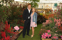 Actor DAMIAN LEWIS and SOPHIA MYLES at the 2005 RHS Chelsea Flower Show on 23rd May 2005<br /><br />NON EXCLUSIVE - WORLD RIGHTS