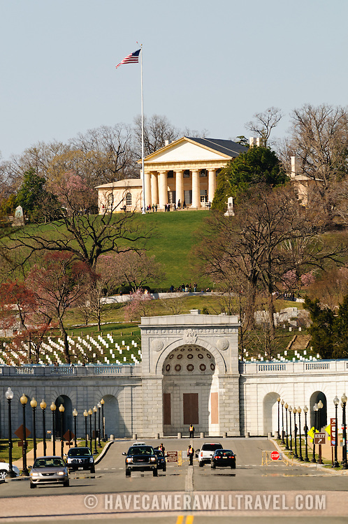 Arlington House, also known as the Robert E. Lee Memorial on top of the hill of Arlington National Cemetery. The shot is taken from Memorial Bridge looking west. In the foreground is the entrance of the cemetery with the John F. Kennedy gravesite directly behind that.