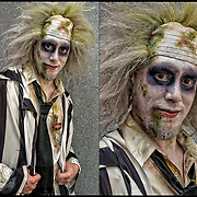 Cosplay attendee in his  costume, as  Beetlejuice.<br /> <br /> Beetlejuice  is a comedy-fantasy film directed by Tim Burton. The plot revolves around a recently deceased young couple  who become ghosts haunting their former home, and an obnoxious, devious ghost named Betelgeuse (pronounced &quot;Beetlejuice&quot;, from the Netherworld who tries to scare away the new inhabitants permanently.<br /> <br /> Cosplay, a contraction of the words costume play, is a performance art in which participants called cosplayers wear costumes and fashion accessories to represent a specific character.<br /> <br /> Cosplayers often interact to create a subculture and a broader use of the term &quot;cosplay&quot; applies to any costumed role-playing in venues apart from the stage. Any entity that lends itself to dramatic interpretation may be taken up as a subject and it is not unusual to see genders switched. Favorite sources include manga and anime, comic books and cartoons, video games, and live-action films and television series.<br /> <br /> The New York Comic Con convention, is a celebration of comic books, graphic novels, sci-fi and video games, toys, movies and television. The convention brings together celebrities as well as fans of fantasy role playing, Comic-Con is the business of pop culture.