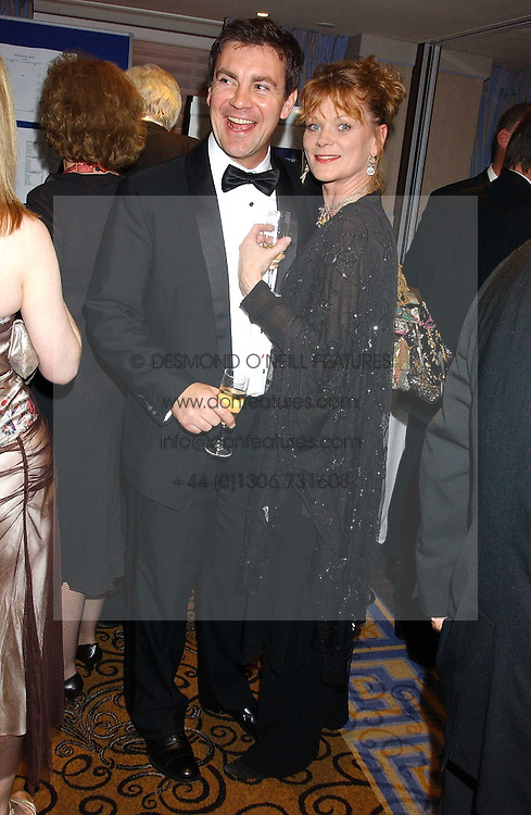 Actress SAMANTHA BOND and her husband actor ALEX HANSON at a ball in aid of Cystic Fibrosis Trust held at the London Marriott, Grosvenor Square, London on 28th October 2005.<br />