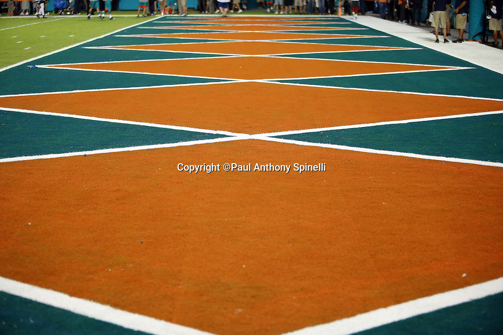 The end zone is painted in a throwback color and design for the Miami Dolphins NFL week 14 regular season football game against the New York Giants on Monday, Dec. 14, 2015 in Miami Gardens, Fla. The Giants won the game 31-24. (©Paul Anthony Spinelli)