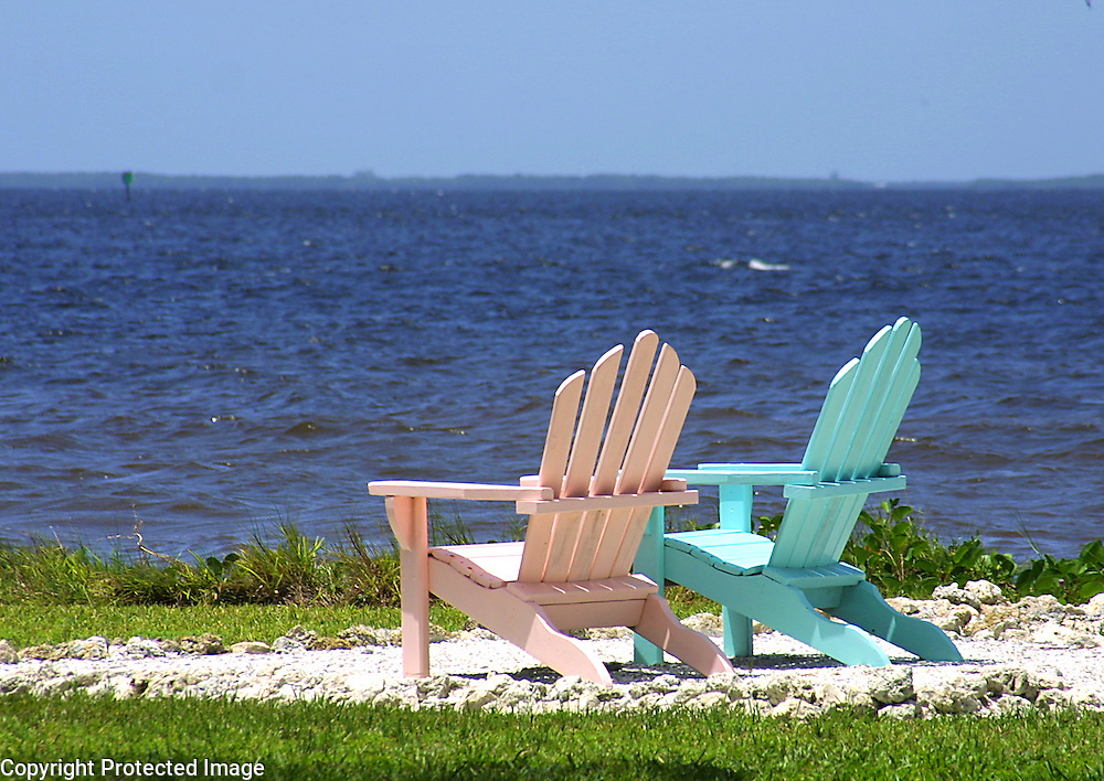 Two beach chairs offer an enticing view of Charlotte Harbor and the Gulf of Mexico near Bokeelia, Florida on Pine Island.