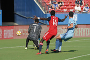 FC Dallas Forward Dominique Badji (14) positions himself for a goal while NYCFC defender Eric Miller (5) and goalkeeper Sean Johnson (1) prepare to block during a MLS soccer game, Sunday, Sept. 22, 2019, in Frisco, Tex. FC Dallas and New York FC draw 1-1 (Wayne Gooden/Image of Sport)