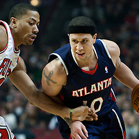 19 December 2009: Atlanta Hawks guard Mike Bibby drives past Chicago Bulls guard Derrick Rose during the Chicago Bulls 101-98 victory in overtime over the Atlanta Hawks at the United Center, in Chicago, Illinois, USA.