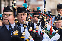 London, March 13th 2016. The annual St Patrick's Day Parade takes place in the Capital with various groups from the Irish community as well as contingents from other ethnicities taking part in a procession from Green Park to Trafalgar Square.  PICTURED: A pipe band marches along Piccadilly. ©Paul Davey<br /> FOR LICENCING CONTACT: Paul Davey +44 (0) 7966 016 296 paul@pauldaveycreative.co.uk