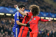 David Luiz of Paris Saint-Germain (right) reacts as Diego Costa of Chelsea puts his head towards him during the UEFA Champions League match at Stamford Bridge, London<br /> Picture by David Horn/Focus Images Ltd +44 7545 970036<br /> 11/03/2015