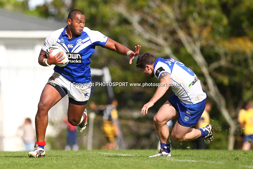 Ukuma Ta'ai looks to fend off a tackle during a NSW Cup rugby league game, Auckland Vulcans v Canterbury Bankstown Bulldogs, Birkenhead War Memorial, Auckland, New Zealand. Saturday 19 May, 2012. Photo: Wayne Drought / photosport.co.nz