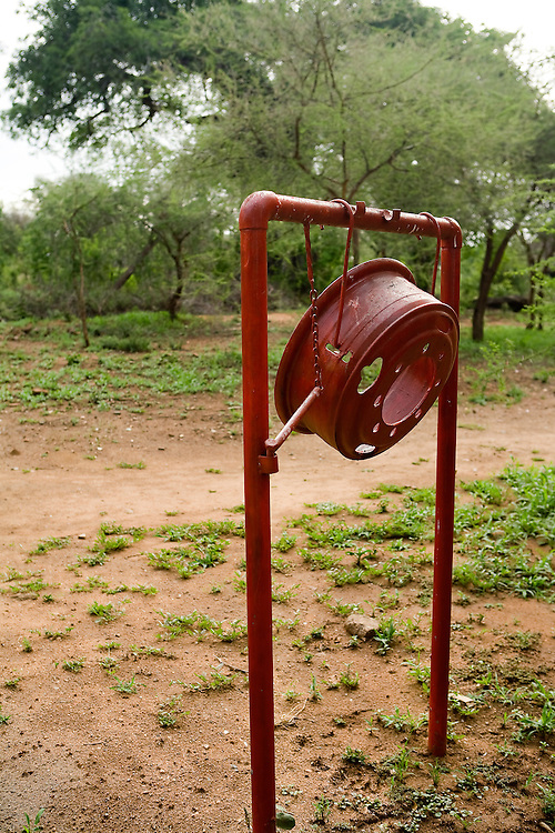 The wheel rim and mallet are low-tech but effective alarm for fires, dangerous animals in the area, and other emergencies. Tarangire National Park, Tanzania