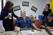 ALBUQUERQUE, NM - OCTOBER, 13: Republican gubernatorial candidate Susana Martinez, left, chats with volunteer Teddy Adams at her campaign headquarters on October 13, 2010 in Albuquerque New Mexico. (Photo by Steven St. John/For The Washington Post)