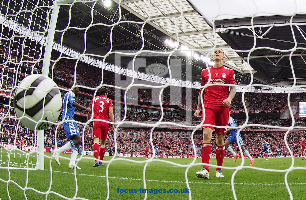Picture by Andrew Tobin/Focus Images Ltd. 07710 761829. 5/5/12. Daniel Agger of Liverpool walks to pick the ball out of the net after Didier Drogba scored Chelsea's second goal during the FA Cup Final between Chelsea and Liverpool at Wembley Stadium, London