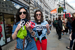 © licensed to London News Pictures. London, UK 12/05/2012. Lucia Azcarate and Raquel Suarez manages to grab several free underwears from 100 Lifeguards who promote opening of the new Gilly Hicks and Hollister Flagship Stores on Regent Street, this morning (12/05/12). Photo credit: Tolga Akmen/LNP