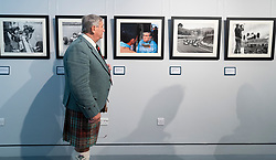 Duns, Scotland, UK. 29 August 2019. Official opening of the new Jim Clark Motorsport Museum in Duns, Berwickshire, UK. The museum was opened by Sir Jackie Stewart and is operated but the Jim Clark trust. Pictured, Visitor looking at vintage photographs on display.  Iain Masterton/Alamy Live News.