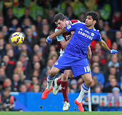 Burnley's Michael Keane and Chelsea's Diego Costa compete for the ball - Photo mandatory by-line: Mitchell Gunn/JMP - Mobile: 07966 386802 - 21/02/2015 - SPORT - Football - London - Stamford Bridge - Chelsea v Burnley - Barclays Premier League