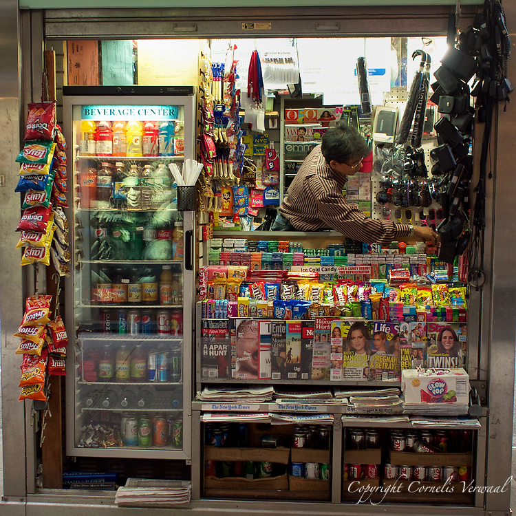 Newsstand on Broadway near Lincoln Center - I'm always amazed at how many goods these vendors neatly stash  in their small spaces.