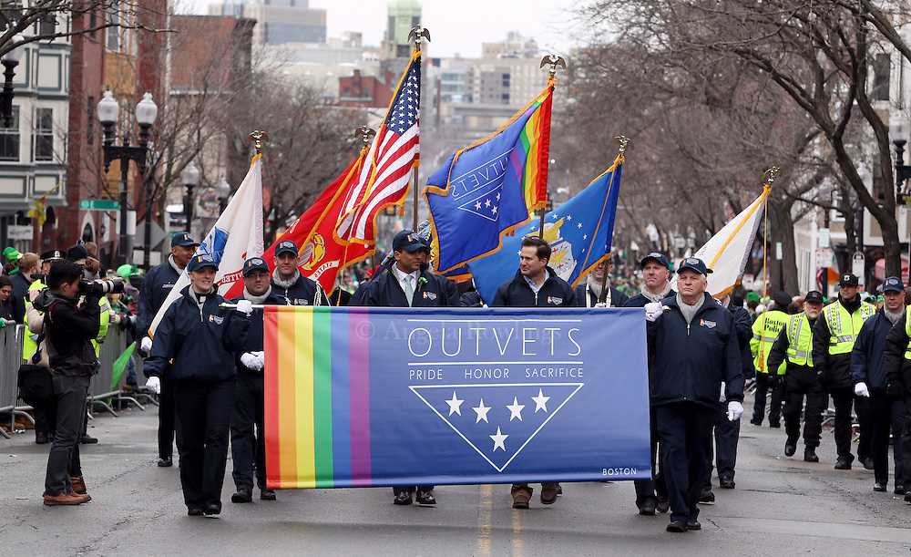 (Boston, MA - 3/15/15) Rep. Seth Moulton marches with OutVets during the St. Patrick's Day Parade in South Boston, Sunday, March 15, 2015. Staff photo by Angela Rowlings.