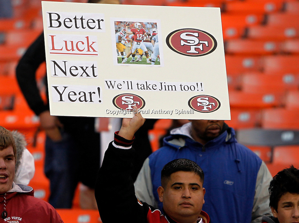 A San Francisco 49ers fan holds up a sign referring to Stanford's head coach Jim Harbaugh and Stanford Cardinal quarterback Andrew Luck during the NFL week 17 football game against the Arizona Cardinals on Sunday, January 2, 2011 in San Francisco, California. The 49ers won the game 38-7. (©Paul Anthony Spinelli)
