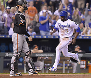 May 12, 2017 - Kansas City, MO, USA - Kansas City Royals' Lorenzo Cain scores in front of Baltimore Orioles catcher Caleb Joseph in the eighth inning on Friday, May 12, 2017 at Kauffman Stadium in Kansas City, Mo. (Credit Image: © John Sleezer/TNS via ZUMA Wire)