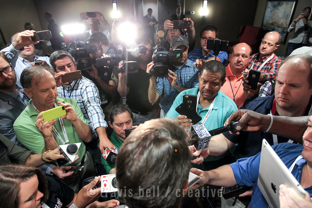 Print, radio, television and internet media gather around Muschamp before he he heads to an even larger press gathering. ©Travis Bell Photography