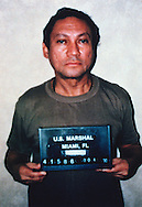Mugshot of General Manuel Noriega after his arrest by US authorities, January 1990. Noriega surrendered to the Americans after taking refuge in the Papal nuncio's residence in Panama City.