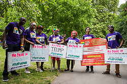 London, UK. 6 July, 2019. Activists from African Rainbow Family prepare to take part in a London Pride Solidarity March at the very rear of Pride in London - stewards tried to prevent them from joining - in solidarity with those for whom Pride in London is inaccessible and in protest against the corporatisation of Pride in London.