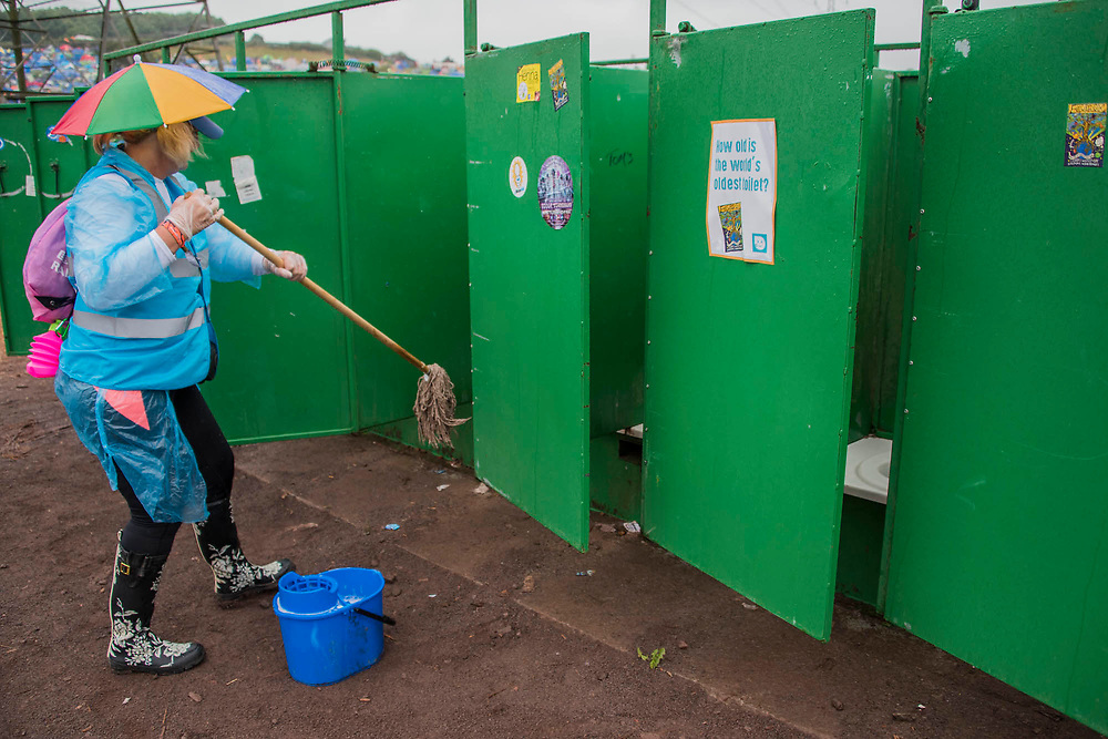 The Water Aid toilet cleaning brigade arrives- dirty work. The 2017 Glastonbury Festival, Worthy Farm. Glastonbury, 23 June 2017