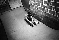 Damian takes a break after falling on the mini-ramp during alate night of skateboarding at the Danger Room........................