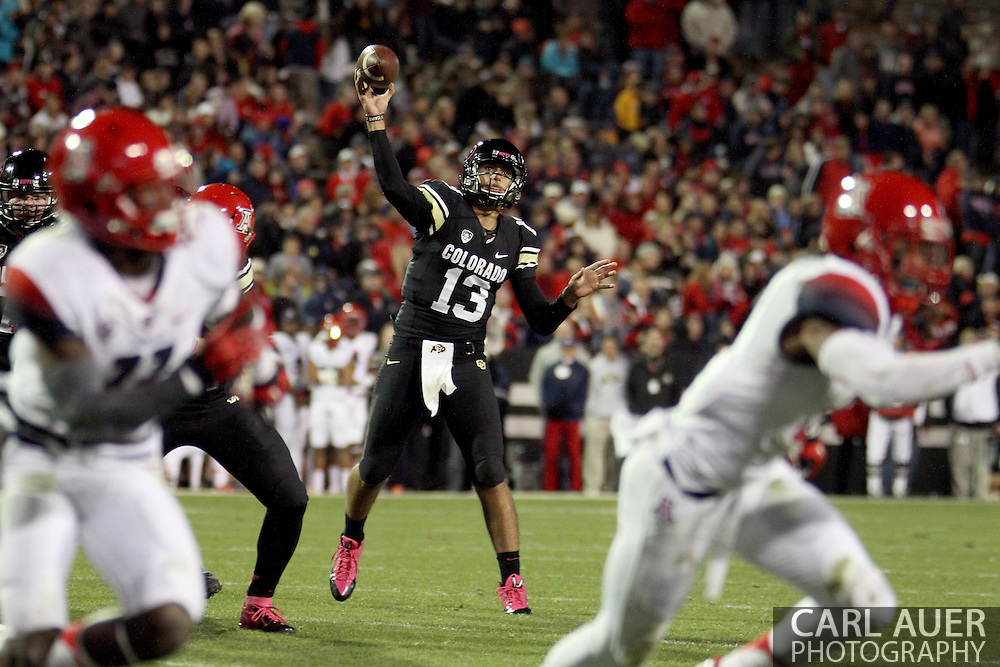 October 26th, 2013:  Colorado Buffaloes freshman quarterback Sefo Liufau (13) throws the ball in the third quarter of action in the NCAA football game between the University of Arizona Wildcats and the University of Colorado Buffaloes at Folsom Field in Boulder, Colorado