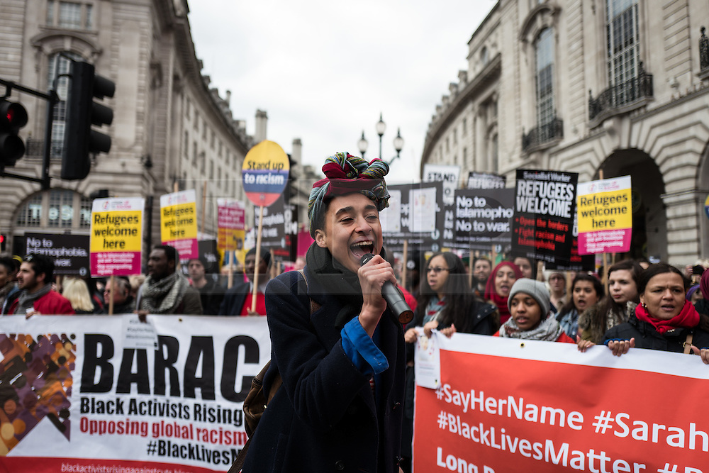 © Licensed to London News Pictures. 19/03/2016. London, UK. Demonstrators pass through London's Piccadilly Circus. Thousands march through central London on UN anti-racism day to demand that the British government accept a greater share of refugees seeking asylum in Europe. Photo credit : Rob Pinney/LNP