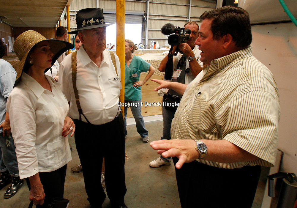 June 8, 2010; Buras, LA, USA; Plaquemines Parish President, Billy Nungesser talks with New Orleans Saints owner Tom Benson and his wife Gayle at the Tri-State Bird Center at Fort Jackosn. The entire team held a rally at Fort Jackson and visited with members of the small Plaquemines Parish fishing community of Buras that has been impacted by the oil spill. (Photographer: Derick E. Hingle).