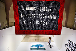 "© Licensed to London News Pictures. 29/10/2019. LONDON, UK. ""Punchcard Economy"", 2013, by Sam Meech, a machine knitted banner made with digital imaging software. Preview of ""24/7: A Wake-Up Call For Our Non-Stop World"", a new exhibition opening on 31 October at Somerset House.  The show examines our inability to switch off from our 24/7 culture.  Over 50 multi-disciplinary works explore the pressure to produce and consume information around the clock. taking visitors on a 24-hour cycle from dawn to dusk through interactive installations.  Photo credit: Stephen Chung/LNP"