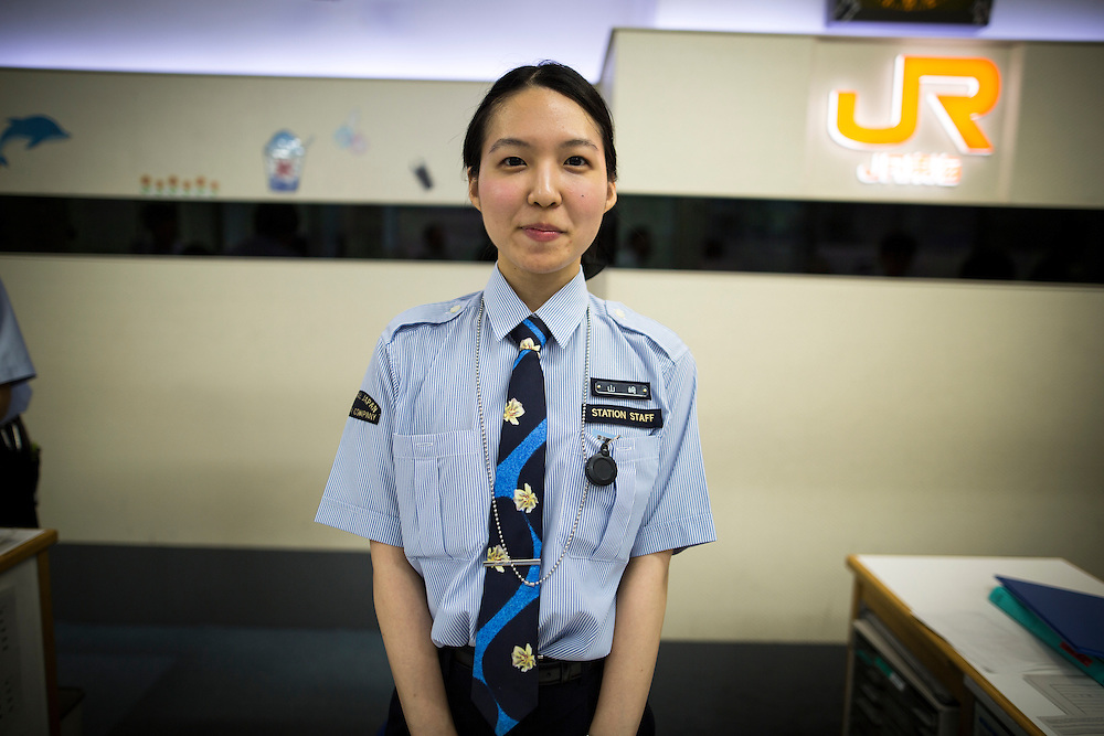 TOKYO, JAPAN - JULY 13 : A JR woman posed for a photo is seen at the ticket counter of Tokyo Station on Wednesday, July 13, 2016, Tokyo, Japan.<br />   <br /> Photo: Richard Atrero de Guzman