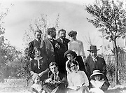 Maurice Ravel, 1875-1937, French composer, pianist and conductor (front) with friends at the home of Florent Schmitt, 1870-1958, French composer (standing, in profile), photograph, c. 1910, by unknown photographer. Copyright © Collection Particuliere Tropmi / Manuel Cohen