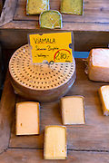 Viamala Schweizer Bergkase (Swiss) cheese on a stall in the Viktualienmarkt in Munich, Bavaria, Germany